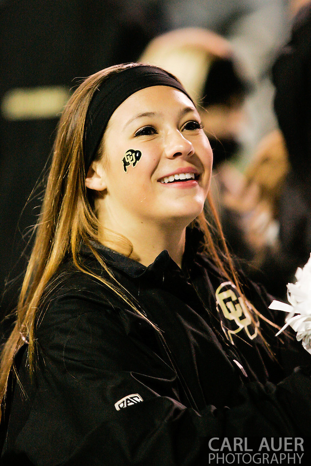 November 23rd, 2013:  A Colorado Cheerleader during the fourth quarter of the NCAA Football game between the University of Southern California Trojans and the University of Colorado Buffaloes at Folsom Field in Boulder, Colorado (Carl Auer/ZUMAPRESS.com)