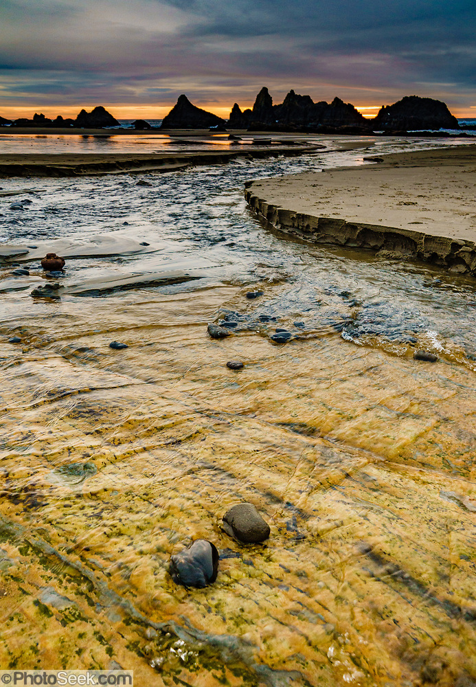 Colorful seaside rock patterns in Hill Creek near Seal Rock State Recreation Site, on the Oregon coast, USA. We stayed at the adjacent Seal Rocks RV Cove. (© Tom Dempsey / PhotoSeek.com)