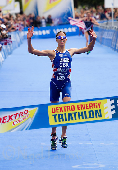 06 AUG 2011 - LONDON,GBR - Helen Jenkins (GBR) celebrates winning the women's round of triathlon's ITU World Championship Series which made her eligible for the British team for the 2012 Olympic Games (PHOTO (C) NIGEL FARROW) (NIGEL FARROW/(C) 2011 NIGEL FARROW)