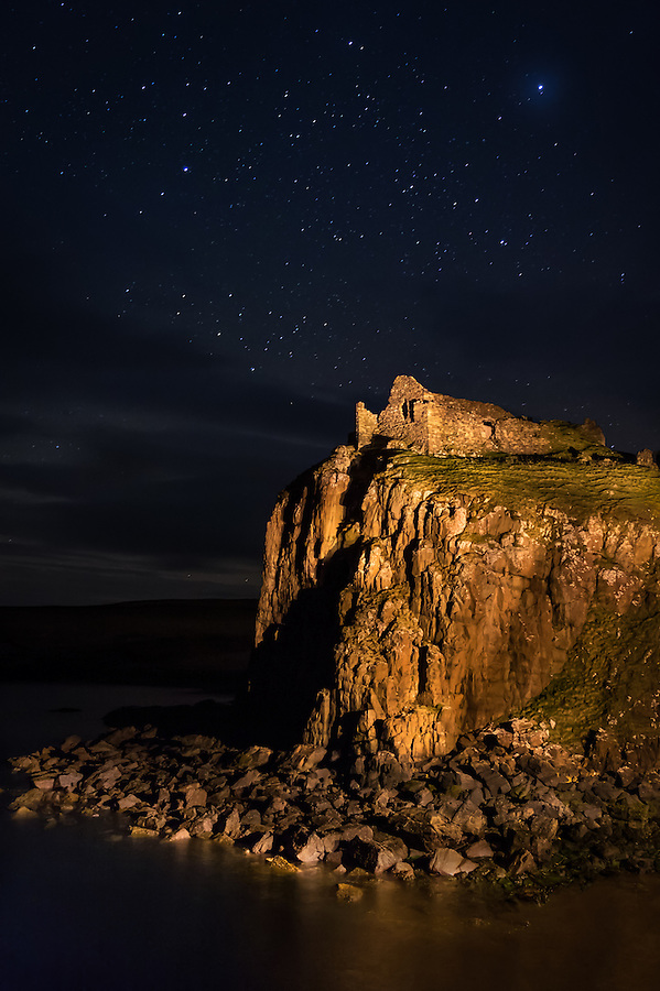 SCOTLAND - CIRCA APRIL 2016: Duntulm Castle at night. The castle stands ruined on the north coast of Trotternish, on the Isle of Skye in Scotland, near the hamlet of Duntulm. (Daniel Korzeniewski)
