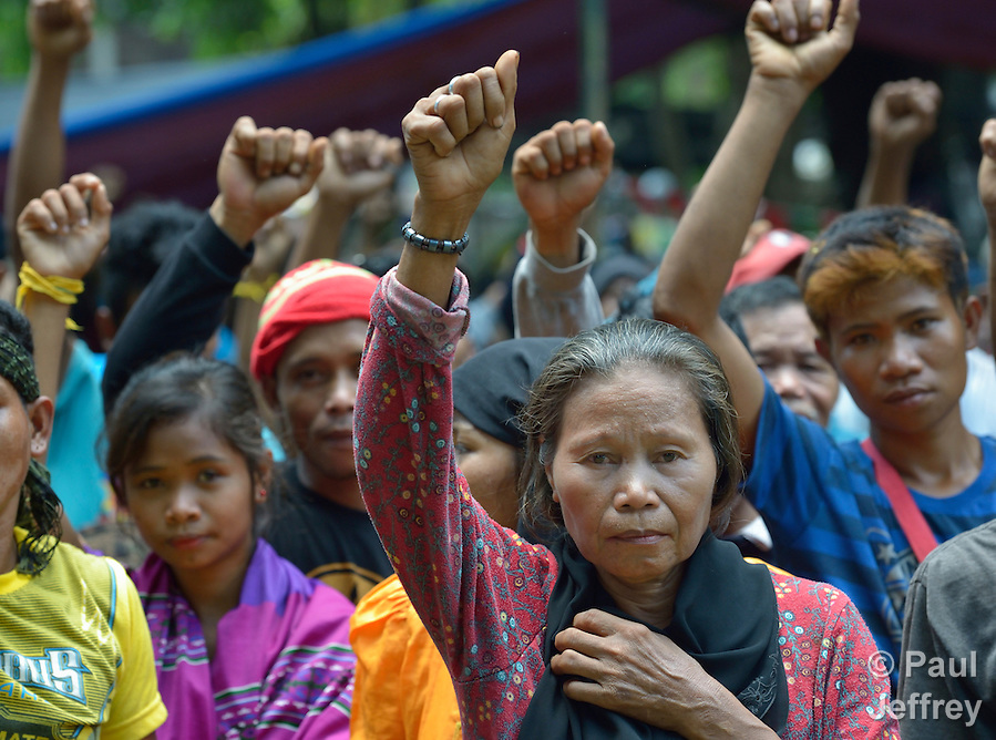 Indigenous people raise clenched fists during a demonstration in Koronadal City, on the southern Philippine island of Mindanao. Many of the indigenous are displaced, having been chased out of their rural villages by paramilitary squads. (Paul Jeffrey)