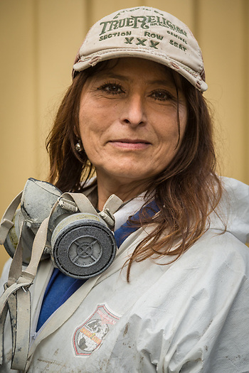 """""""I've been painting for 30 years.  I was not happy making $10 an hour.  I needed to get out of the house and find a way to raise my two children.""""  -Professional painter and Santa Rosa resident Angelica Beltran prepares to paint a newly constructed home on Cedar Street in Calistoga. (Clark James Mishler)"""