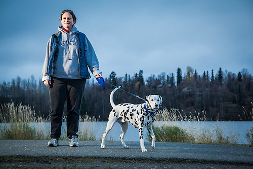 Peggy Wilcox and her 10 month old Dalmatian, Angus, at Westchester Lagoon, Anchorage (Clark James Mishler)