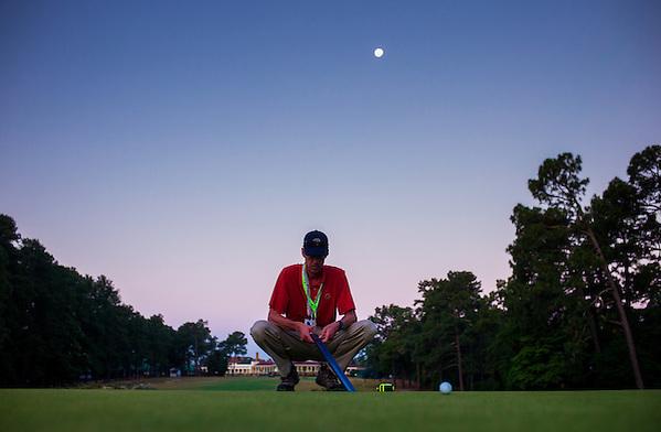USGA agronomist Chris Hartwiger uses a Stimpmeter while setting up the course for the final round of the 2014 U.S. Open at Pinehurst Resort & C.C. in Village of Pinehurst, N.C. on Sunday, June 15, 2014.  (Copyright USGA/Darren Carroll) (Darren Carroll/USGA Museum)