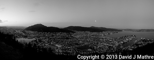 Moon Over Bergen Norway at Dawn from Mount Fløyen. Image taken with a Leica X2 camera (ISO 400, 24 mm, f/2.8, 1/60 sec). In camera B&W. Composite panorama of 9 vertical images using PTGui Pro 9. (David J. Mathre)