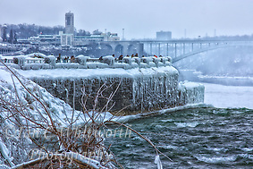 Tourists brave the Canadian winter to view Niagara Falls surrounded by ice and snow. (Ian C Whitworth)