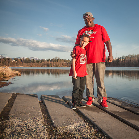 "Medical equipment truck driver Quincy Bolling with his six year old son Quincy, at Westchester Lagoon, Anchorage  ""My wife and I grew up here but we are considering a job with my employer in Ogden Utah.  The pay would be the same, but the cost of living would be greatly reduced. -Quincy Bolling (© Clark James Mishler)"