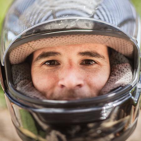 """Allen Schuler with motorcycle helmet.  """"Please make this quick, its in here."""" (© Clark James Mishler)"""