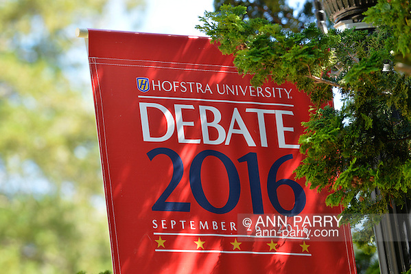 Hempstead, New York, USA. September 13, 2016. Hofstra University Debate 2016 banner, in patriotic red white and blue, is one of many displayed on the campus of Hofstra University, which will host the first Presidential Debate, between H.R. Clinton and D. J. Trump, scheduled for later that month on September 26. Hofstra is first university ever selected for 3 consecutive U.S. presidential debates. (Ann Parry/Ann Parry, ann-parry.com)