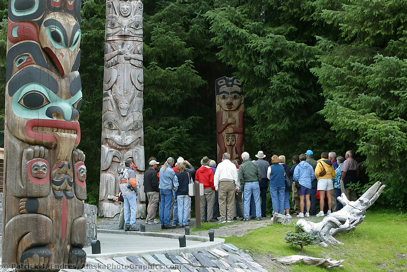 Sitka photos: Tourists view totems in the Sitka National Historic Park. Site of a Tlingit Indian Fort and the battle fought between the Russians and the Tlingits in 1804. (Patrick J. Endres / AlaskaPhotoGraphics.com)