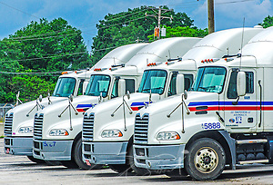 Mack Trucks are pictured outside the headquarters of Comcar Industries, April 16, 2015, in Auburndale, Fla. Approximately 80 percent of the 3,000-truck fleet is comprised of Macks. (Photo by Carmen K. Sisson/Cloudybright) (Carmen K. Sisson/Cloudybright)