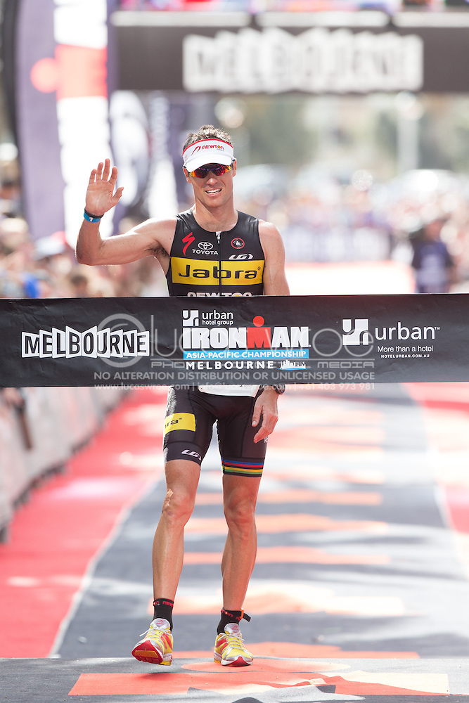 Craig ALEXANDER (AUS) At The Finish. Ironman Asia Pacific Championship Melbourne. Triathlon. Frankston And St Kilda, Melbourne, Victoria, Australia. 24/03/2013. Photo By Lucas Wroe (Lucas Wroe)