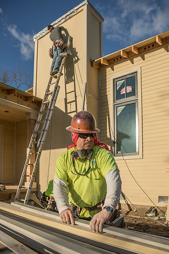 A Yuba City resident with 23 years in the construction trades, Louis Farias works on a new house at the corners of West Money Lane and Mora Avenue in Calistoga. (Clark James Mishler)