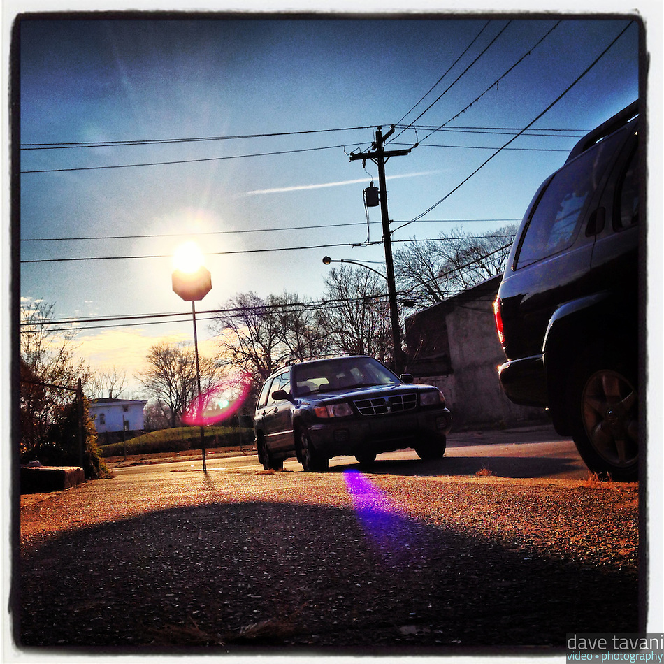 The sun peeks over the top of a stop sign on the corner of Cherokee Street and Washington Lane on December 23, 2012. (Dave Tavani)