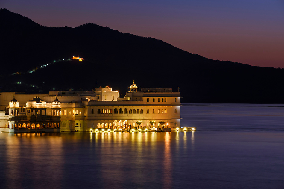 UDAIPUR, INDIA - CIRCA NOVEMBER 2016: Lake Palace Hotel formerly known as Jag Niwas at night in Lake Pichola in Udaipur (Daniel Korzeniewski)