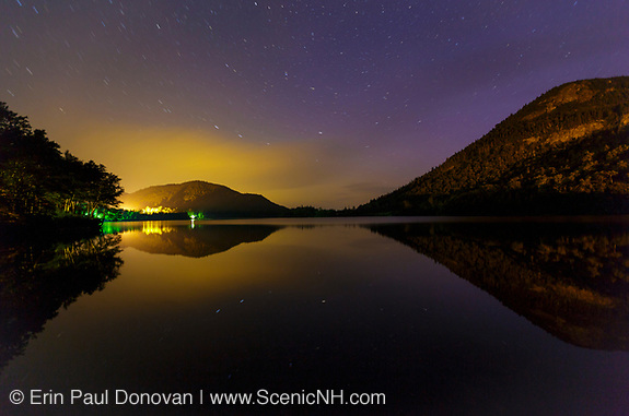 Franconia Notch State Park - Echo Lake at  night in the White Mountains, New Hampshire USA during the summer months. Artists Bluff can be see on the left.