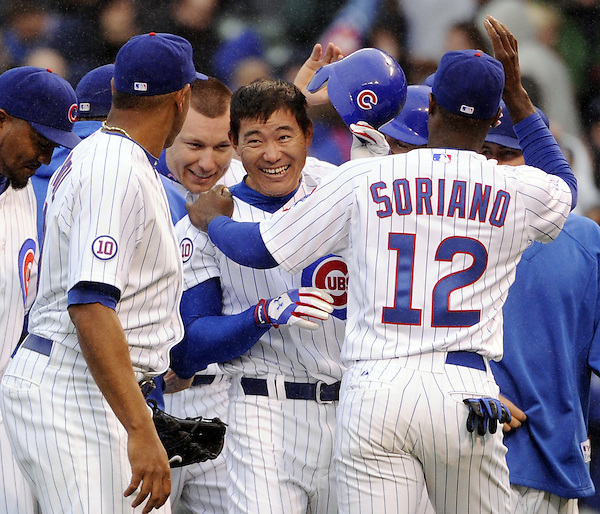 CHICAGO - MAY  07:  Kosuke Fukudome #1 of the Chicago Cubs is mobbed by teammates after hitting a walk-off game winning single off of Francisco Cordero #48 of the Cincinnati Reds in the bottom of the ninth inning on May 7, 2011 at Wrigley Field in Chicago, Illinois.  The Cubs defeated the Reds 3-2.  (Photo by Ron Vesely)  Subject:   Kosuke Fukudome;Francisco Cordero (Ron Vesely)