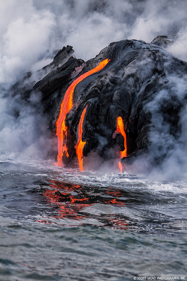 Flowing lava into ocean, creating steam cloud, Kilauea Volcano, Big Island, Hawaii (Scott Mead)