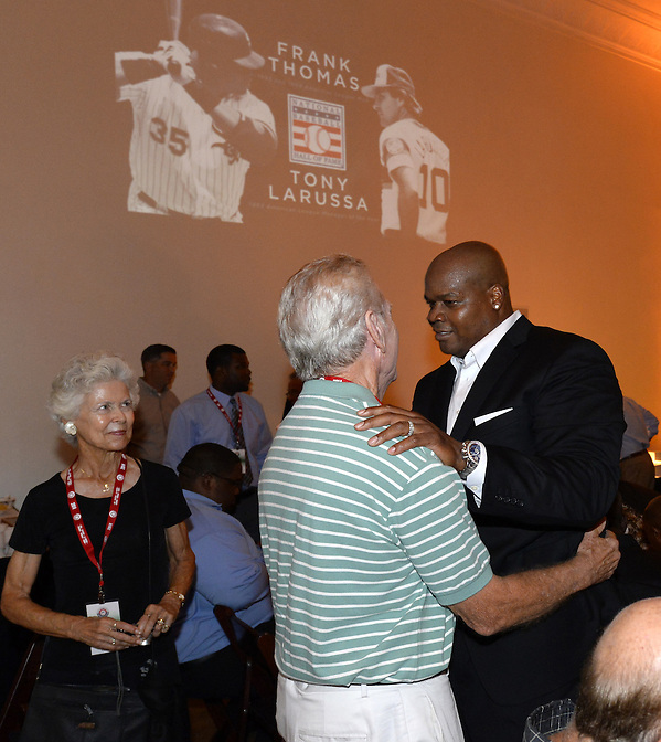 COOPERSTOWN, NY - JULY 26:  2014 Hall of Fame inductee Frank Thomas reunites with former White Sox manager Jeff Torborg as Jeff's wife Suzie looks on during a private reception held at Templeton Hall in Cooperstown, New York on July 26 2014. (Ron Vesely)