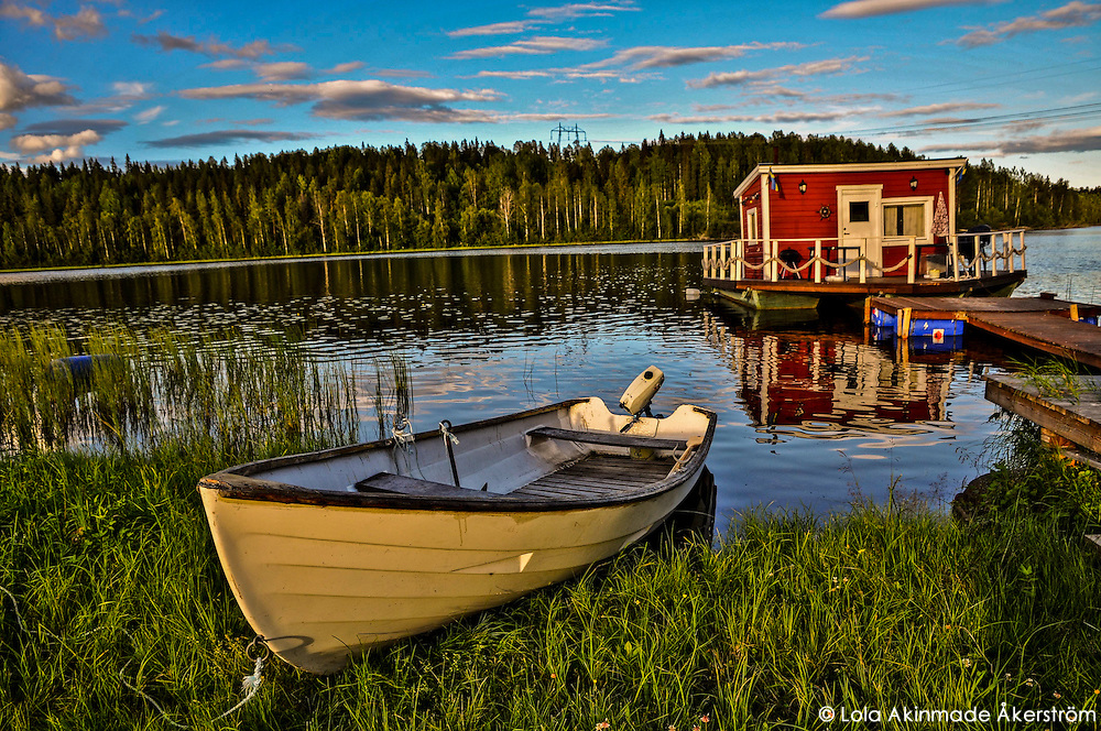 Floating cottage (stuga) and rowboat in Northern Sweden. (Lola Akinmade)