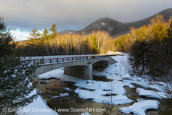 Street bridge, which crosses the East Branch of the Pemigewasset River along the Kancamagus Scenic Byway (Route 112) in Lincoln, New Hampshire on a cloudy winter morning.