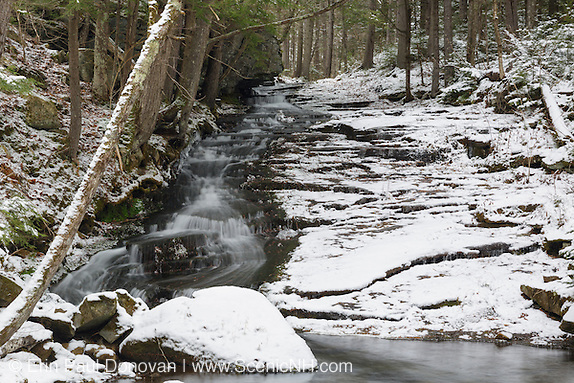 Dearth Brook Falls in Landaff, New Hampshire covered in snow during the winter months. This brook is located on the side of the Cobble Hill Trail.