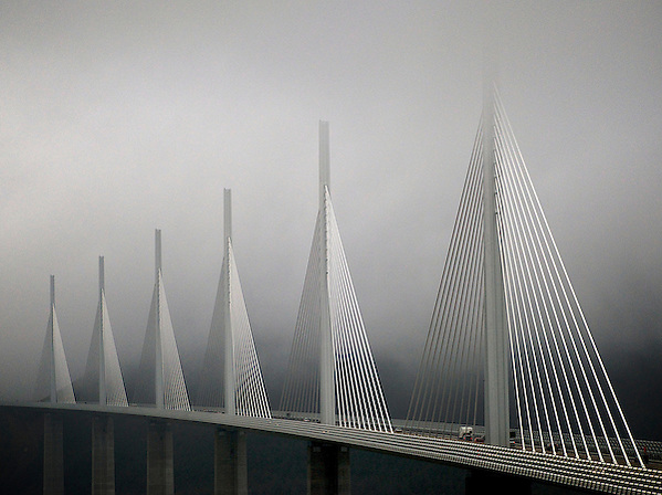 In the late afternoon, as mist and fog descended, a soft light shone through to illuminate the structure of the bridge (Richard McCaig)