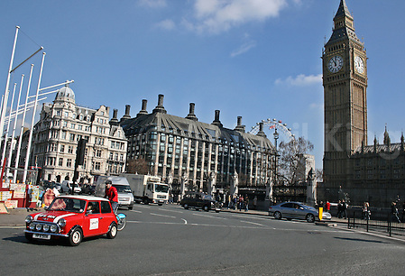 Mini Cooper in London in front of Big Ben & Houses of Parliament