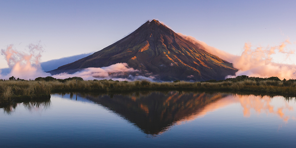 Mount Taranaki across Pouakai tarns in sunset light, Pouakai track, Egmont National Park, New Zealand Ⓒ Davis Ulands | davisulands.com (Davis Ulands/Ⓒ Davis Ulands | davisulands.com)