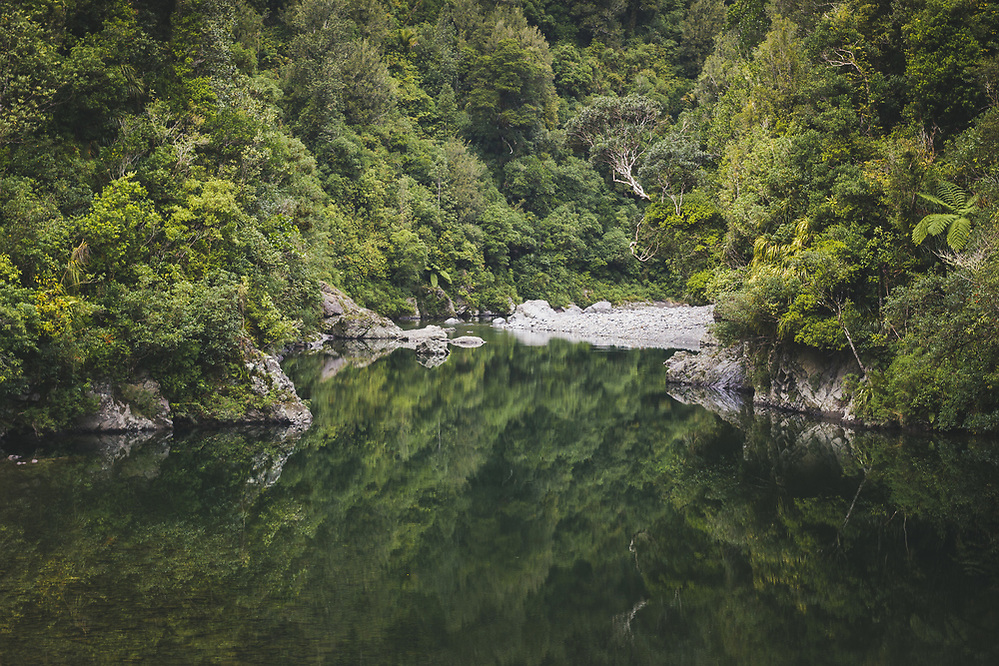 Otaki river mirroring in still morning (Davis Ulands/Ⓒ Davis Ulands | davisulands.com)