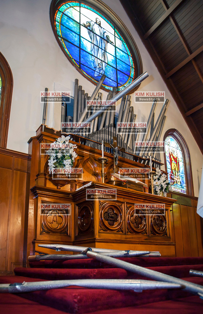 Organ pipes were damaged and toppled inside the historic St. Peters Chapel on Mare Island following the  6.0 earthquake that struck in Napa County on August 24, 2014.  Built in 1901, it is the oldest naval chapel in the U.S.  The  chapel's famous Tiffany stained windows were not damaged. (Kim Kulish)