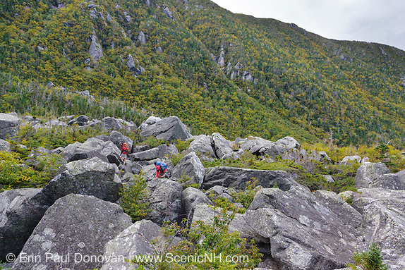 Hikers ascending the Subway Trail in King Ravine in the White Mountains, New Hampshire USA.