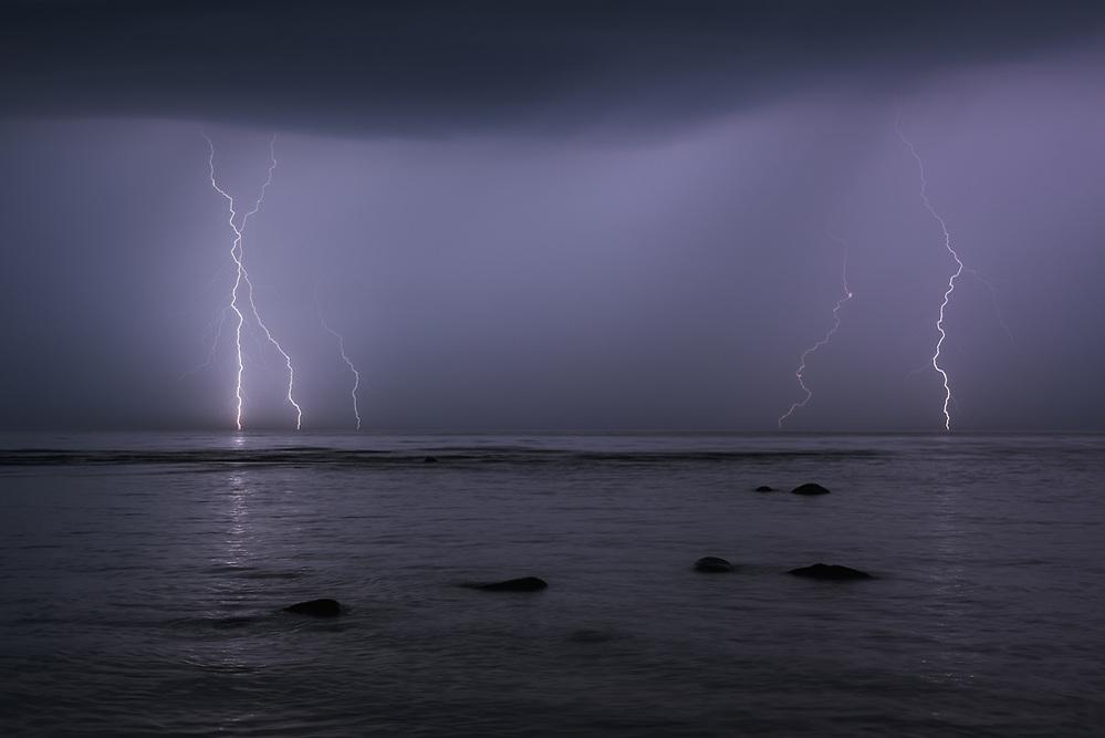 Multiple thunderbolts strikes sea surface at stormy night, Baltic sea near Salacgrīva, Latvia Ⓒ Davis Ulands | davisulands.com (Davis Ulands/Ⓒ Davis Ulands | davisulands.com)