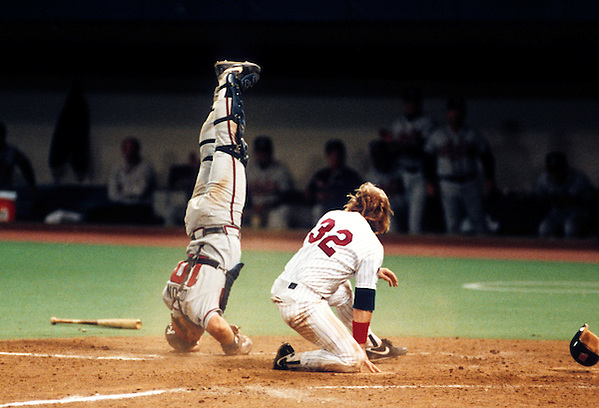 MINNEAPOLIS, MN-OCTOBER 19:  Dan Gladden of the Minnesota Twins bowls over catcher Greg Olson of the Atlanta Braves during Game 1 of the 1991 World Series at The Metrodome on October 19, 1991 in Minneapolis, Minnesota. Gladden was out on the play.  The Twins won the Series 4-3. (Photo by Ron Vesely) (Ron Vesely)