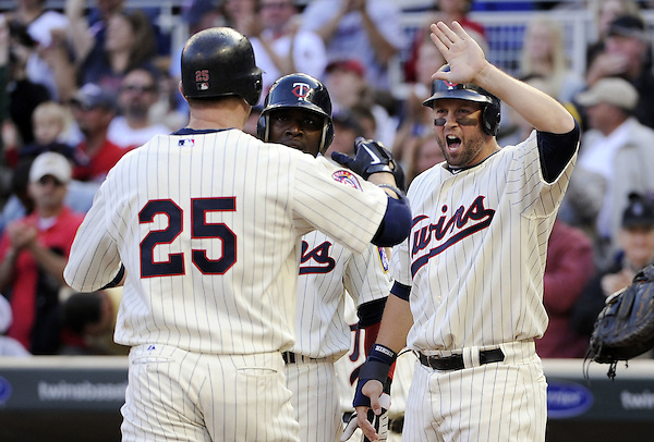 MINNEAPOLIS - SEPTEMBER 04:  Jim Thome #25 is greeted by Michael Cuddyer #5 of the Minnesota Twins after Thome hit his second home run of the game in the fourth inning against the Texas Rangers on September 4, 2010 at Target Field in Minneapolis, Minnesota.  The Twins defeated the Rangers 12-4.  (Photo by Ron Vesely) (Ron Vesely)