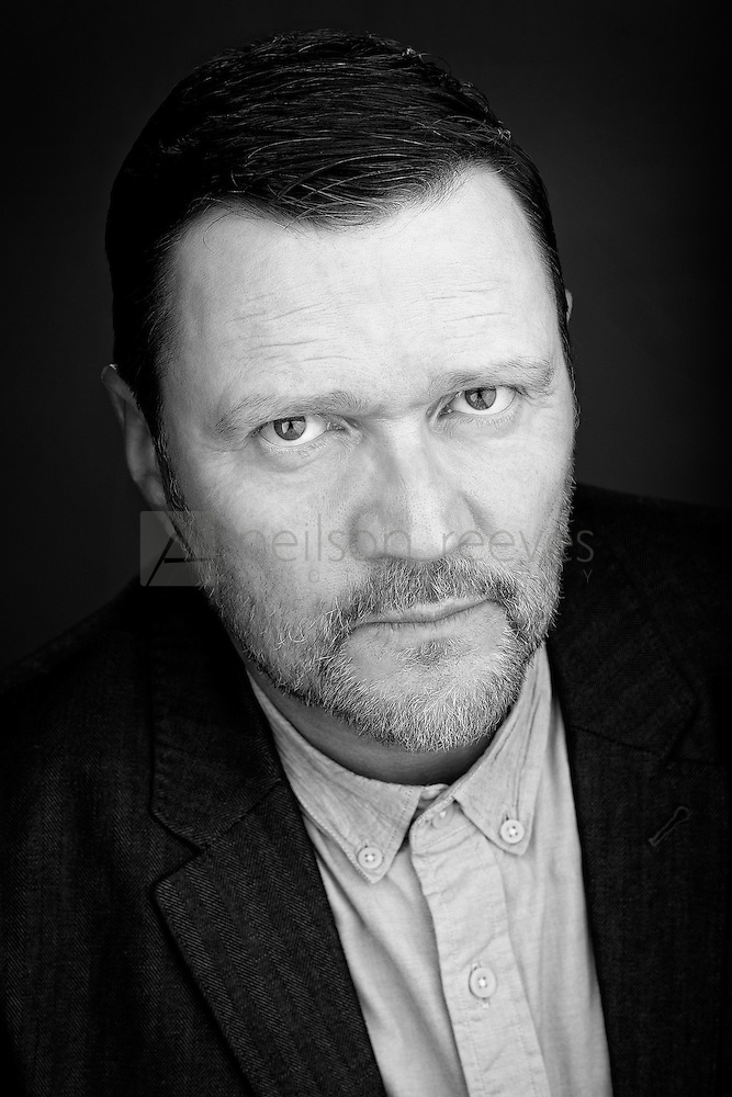 A thought provoking actor headshot in black and white featuring Actor Ian Puleston-Davies (Colin Boulter)