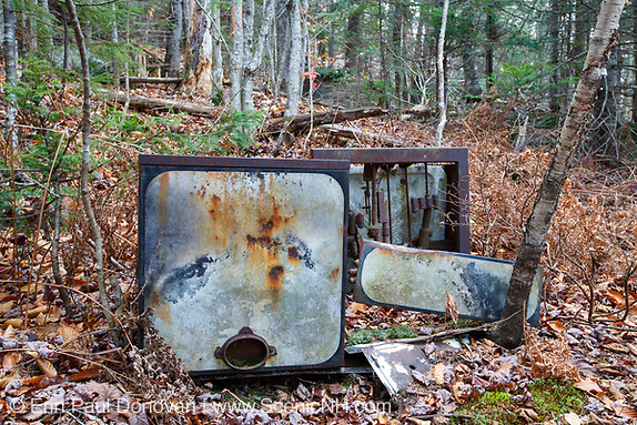 Remnants of a Kitchen Kook Stove Range #866 by American Gas Machine Company, Inc at the abandoned cabin settlement surrounding Elbow Pond in Woodstock, New Hampshire.