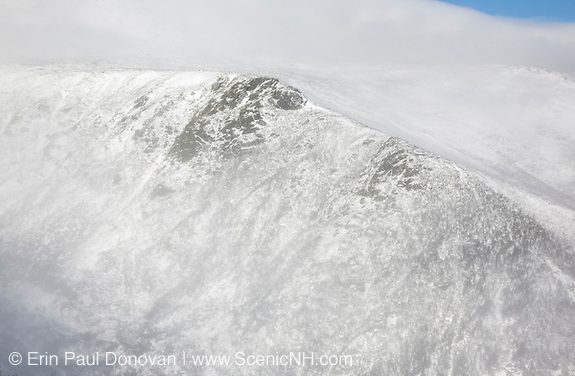 Mount Washington - Tuckerman Ravine in extreme weather conditions during winter months from Boott Spur Trail. Located in the White Mountains, New Hampshire USA. Strong winds cause snow to blow across the mountain tops.