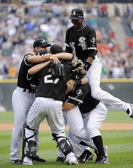 CHICAGO - JULY 23:  Mark Buehrle #56 of the Chicago White Sox is mobbed by teammates after Buehrle recorded the 18th perfect game in major league history against the Tampa Bay Rays on June 23, 2009 at U.S. Cellular Field in Chicago, Illinois.  The White Sox defeated the Rays 5-0.  (Photo by Ron Vesely) (Ron Vesely)