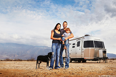 David Couillard and his young, nomadic family stand outside their Airstream trailer while camping in the Anza Borrego Desert of California. (Seth K Hughes)