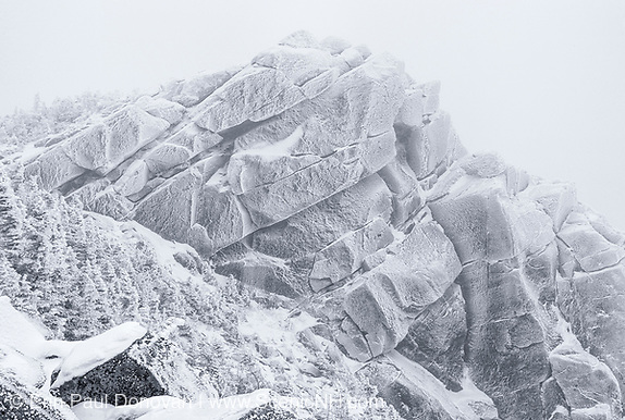 Black and white photo of Mount Liberty in whiteout conditions during the winter months in the White Mountains, New Hampshire.