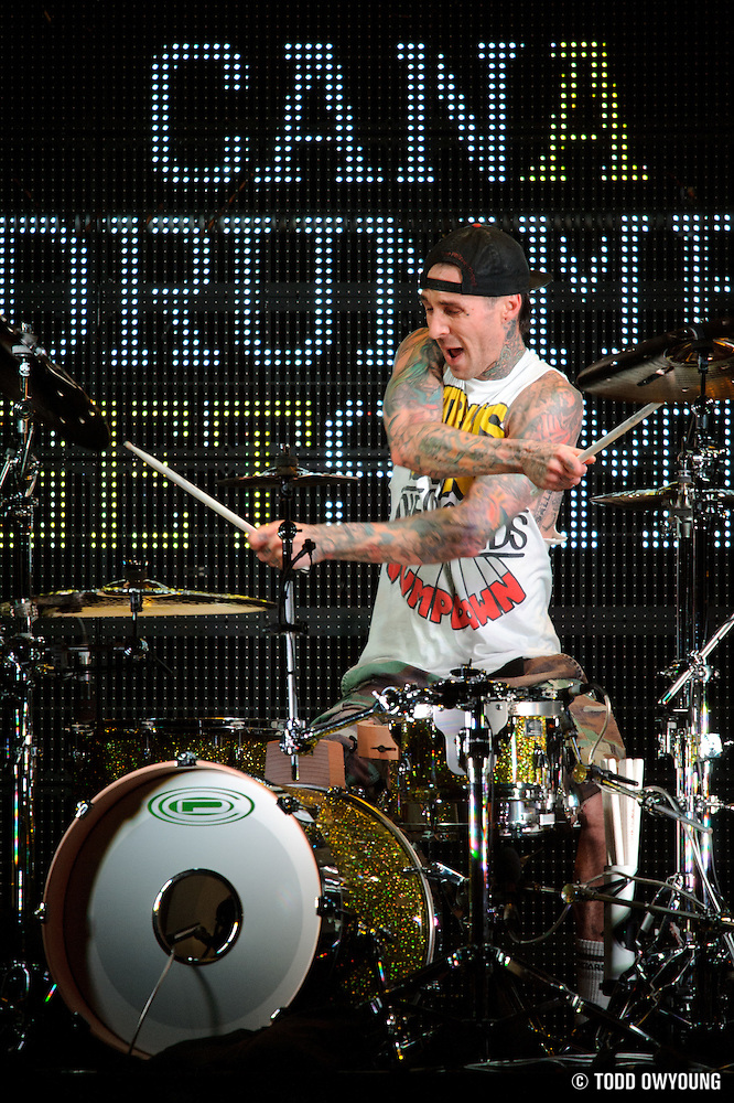 Drummer Travis Barker performing with Mix Master Mike in support of Lil Wayne on the I Am Still Music Tour at the Scottrade Center in St. Louis, MO, on April 10, 2011. (Todd Owyoung)