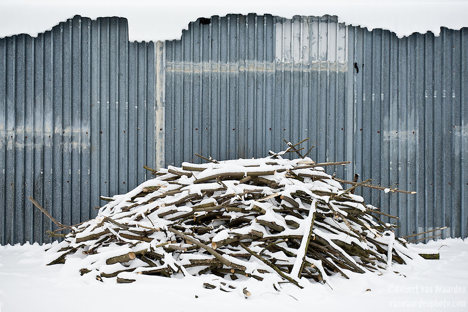 Firewood is piled outside a shed on Miros?awa Horodiuk's farm. (Robert van Waarden)