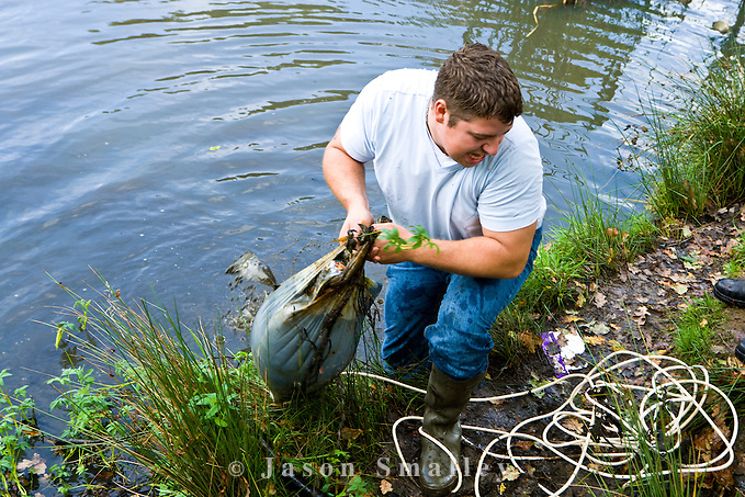 removing rubbish from a pond (Jason Smalley)