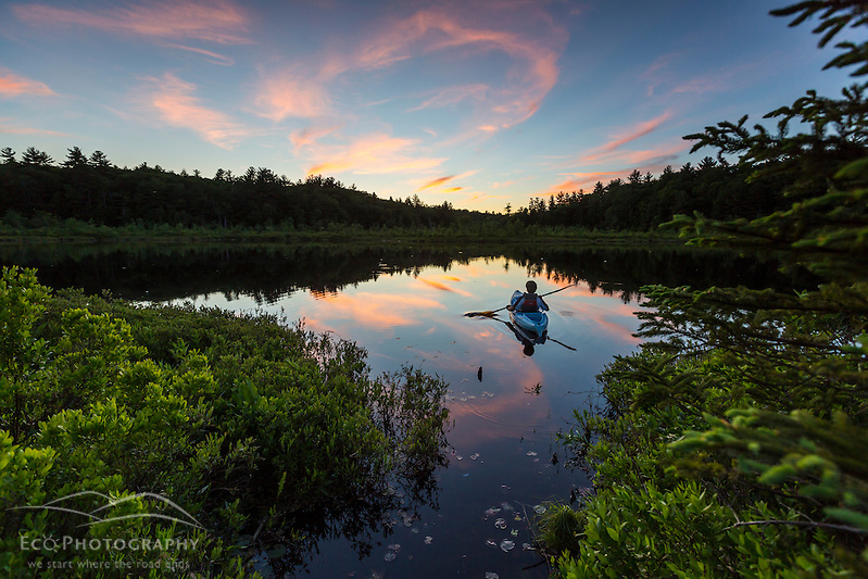 Kayaking a small pond in Barrington, New Hampshire. Sunset. (Jerry and Marcy Monkman)