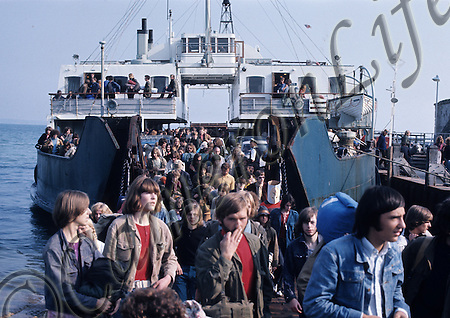Festival crowd arriving at Yarmouth.- .There had been protests and meetings against this inevitability - but all to no avail - as a reported 600,000 men, women and children descended upon the Isle of Wight in the few days leading up to the festival. Transport services ran to breaking point. MV Farringford is shown disembarking at Yarmouth. (Charles Everest / CameronLife Ph)