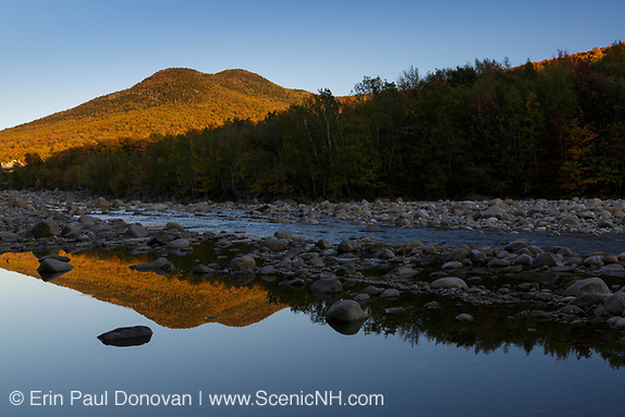 Black Mountain from the along the East Branch of the Pemigewasset River in Lincoln, New Hampshire during the autumn months.