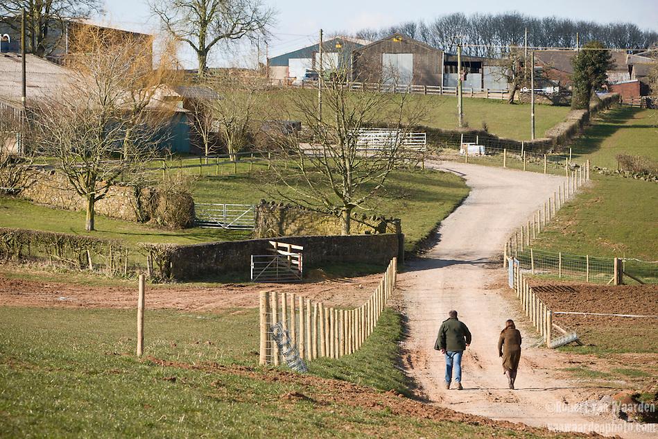 Sue and Andrew Clarke walking up the lane away from the St. Briavels wind turbine. (Robert van Waarden)