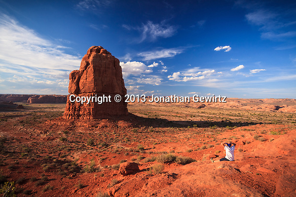 A small visitor surveys rock formations in Arches National Park, Utah. (Jonathan Gewirtz   jonathan@gewirtz.net)