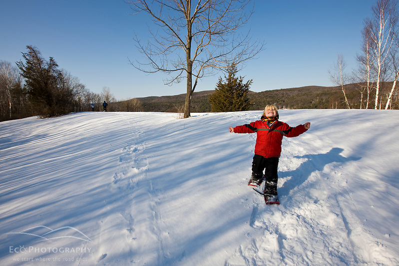 A young boy (age 5) snowshoes at the Tyringham Cobble Reservation in Tyringham, Massachusetts. Berkshire Mountains. The Trustees of Reservations. (Jerry and Marcy Monkman)